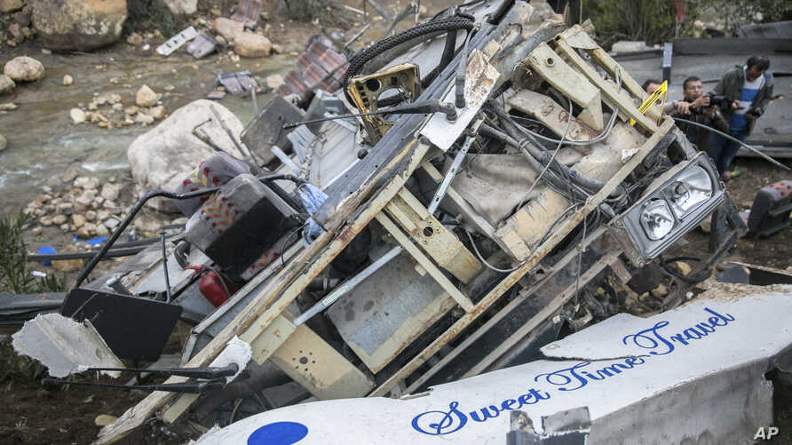 The debris of a regional bus that crashed off a hill are pictured Sunday Dec.1, 2019, causing the death of at least 22 local…
