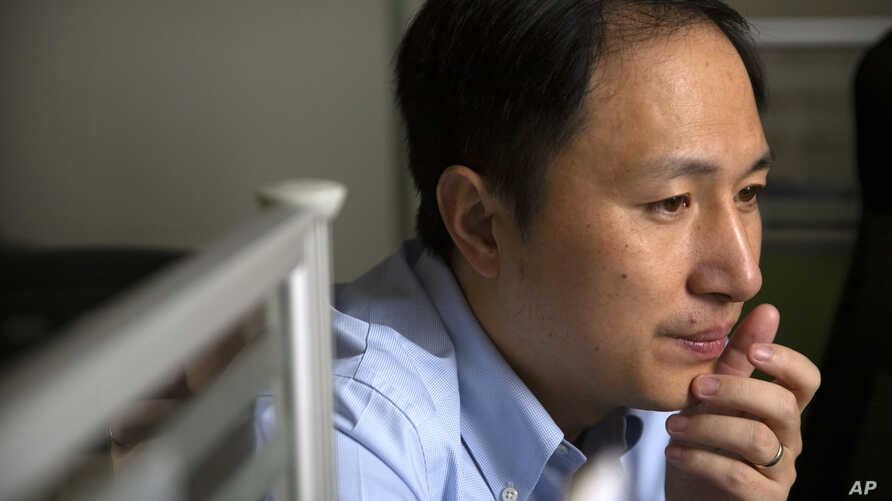 In this Oct. 10, 2018, photo, scientist He Jiankui looks at a computer screen while working at a lab in Shenzhen in southern…