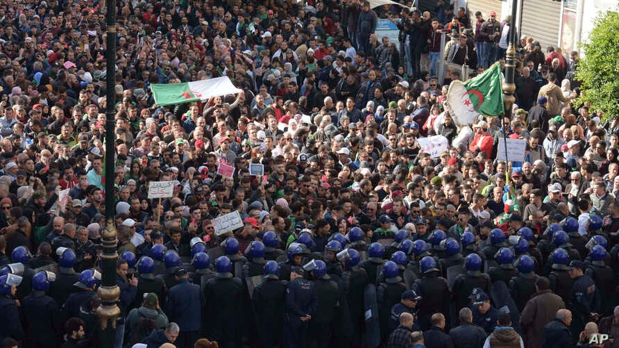 Algerian demonstrators take to the streets in the capital Algiers to protest against the government and reject the upcoming…
