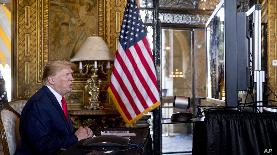 President Donald Trump speaks during a Christmas Eve video teleconference with members of the military at his Mar-a-Lago estate…