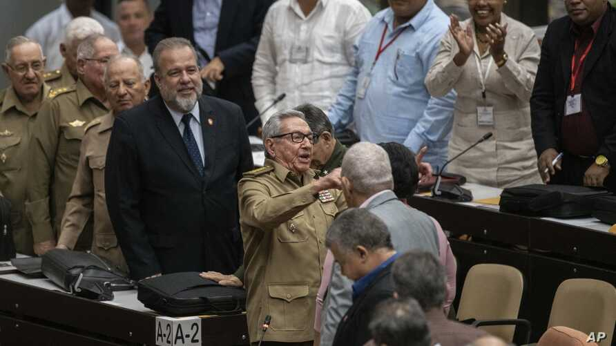 Raul Castro, center, First Secretary of the Communist Party and former president talks with the member of the assembly while…