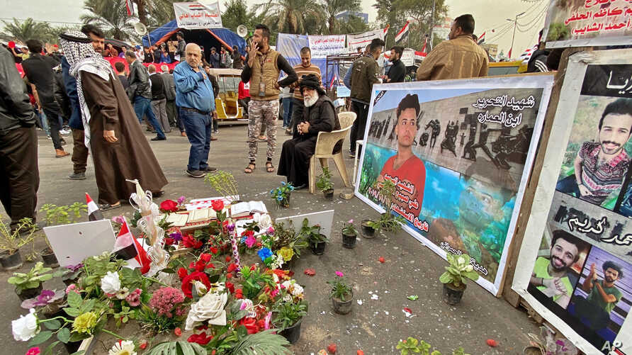 Posters of Anti-government protesters who have been killed in demonstrations are displayed in Tahrir Square during ongoing…