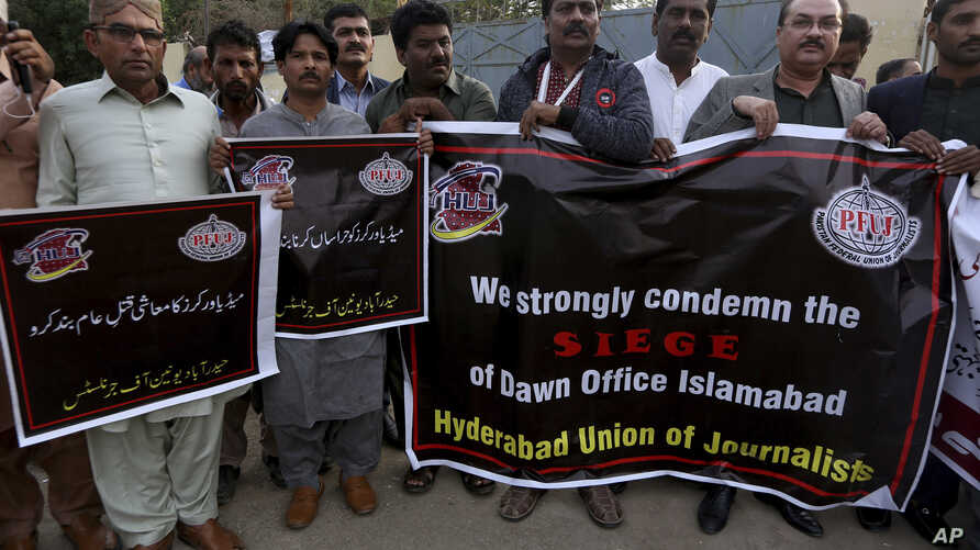 Pakistani journalists take part in a demonstration to show solidarity with the workers of English-language newspaper Dawn, in…
