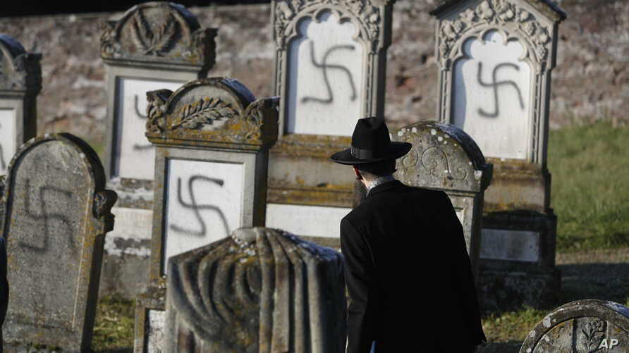 Strasbourg chief Rabbi Harold Abraham Weill watches vandalized tombs in the Jewish cemetery of Westhoffen, west of the city of…