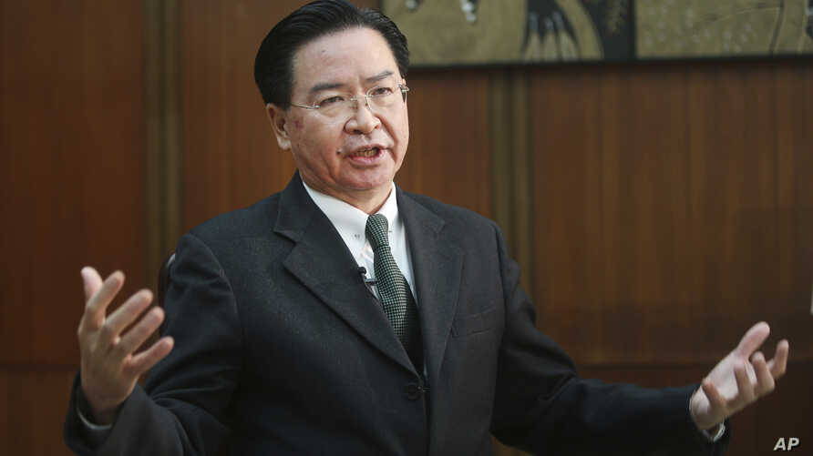 Taiwanese Foreign Minister Joseph Wu speaks during an exclusive interview with The Associated Press at his ministry in Taipei,…