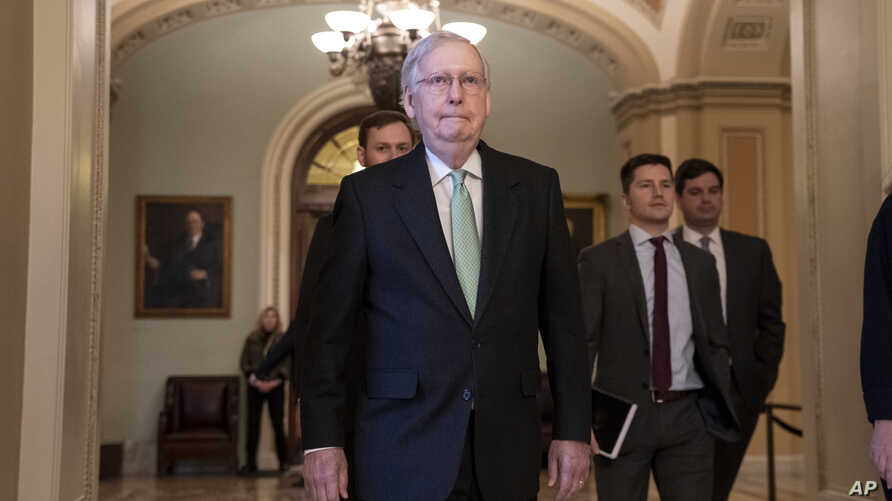 Senate Majority Leader Mitch McConnell, R-Ky., leaves the chamber after criticizing the House Democrats' effort to impeach…