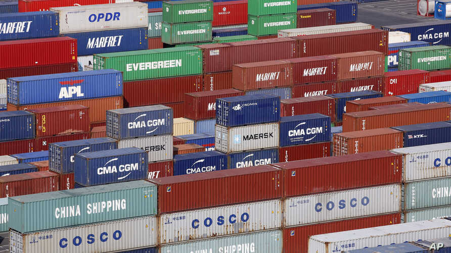 Containers sit stacked at Port 2000 terminal in Le Havre harbour, eastern France, Thursday, Sept. 6, 2018. (AP Photo/Thibault…