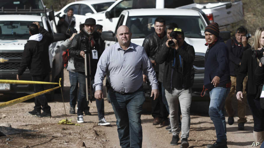 Julian Le Baron arrives where one of the cars belonging to the extended LeBaron family was ambushed by gunmen last year near…