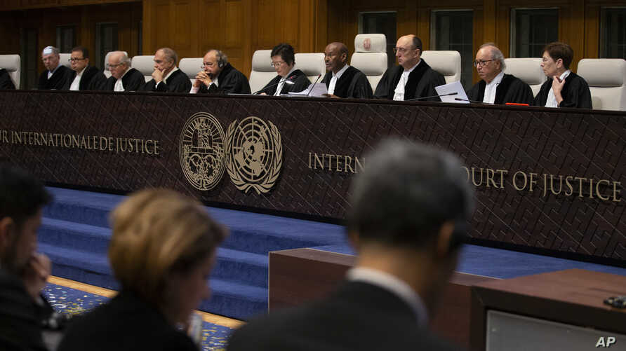 Presiding judge Abdulqawi Ahmed Yusuf, fourth form right, starts reading a ruling at the International Court in The Hague,…