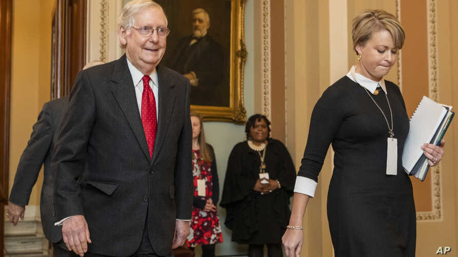 Senate Majority Leader Mitch McConnell, R-Ky., walks from the Senate chamber as the impeachment trial of President Donald Trump…