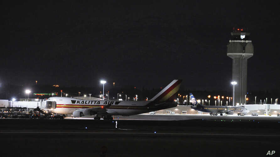 Carrying some 240 American diplomats and citizens, a Boeing 747 aircraft sits on the tarmac of Ted Stevens Anchorage…