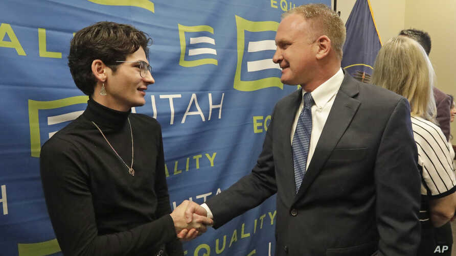 Nathan Dalley, left, shakes hands with Republican Utah Rep. Craig Hall following a news conference about the discredited…