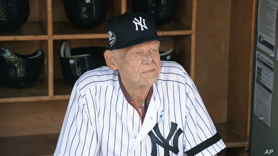 FILE - In this Sunday, June 17, 2018, file photo, New York Yankees' Don Larsen sits in the dugout before the Yankees' Old…