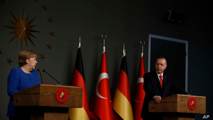 Germany's Chancellor Angela Merkel, left, talks during a joint news conference with Turkey's President Recep Tayyip Erdogan,…