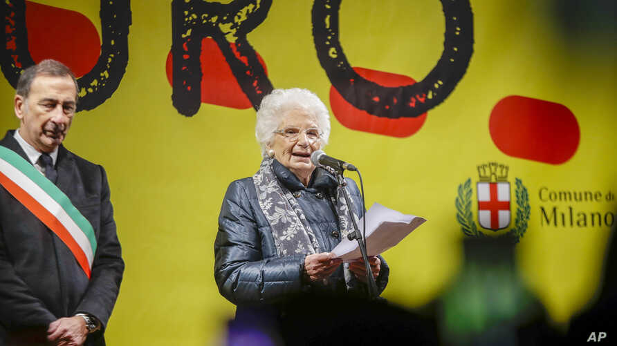 Liliana Segre, an 89-year-old Auschwitz survivor and senator-for-life, right, flanked by Milan's Mayor Giuseppe Sala speaks at…