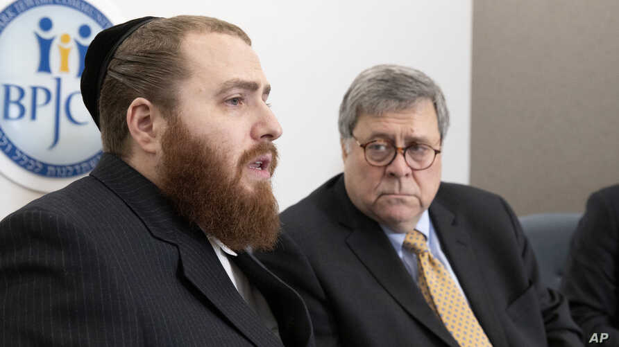 Rabbi Avi Greenstein, left, talks while Attorney General William Barr listens during a meeting of Jewish leaders at the Boro…