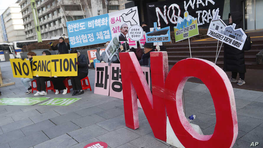 Anti-war activists stage a rally against the South Korean government's decision to send troops to Hormuz Strait, near the U.S…