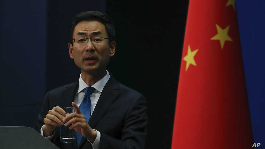 Chinese Foreign Ministry spokesman Geng Shuang gestures as he speaks during a daily briefing at the Ministry of Foreign Affairs…
