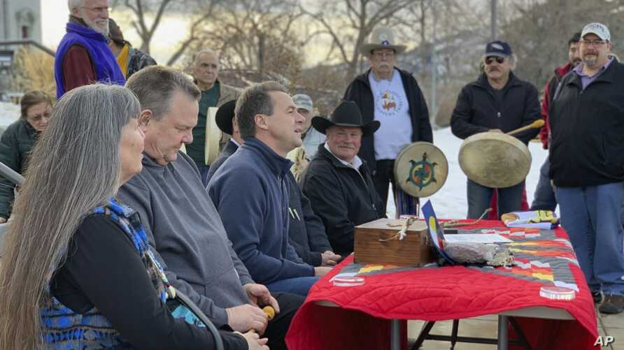 Montana Gov. Steve Bullock, third from left, speaks at an event marking the federal government's formal recognition of the…