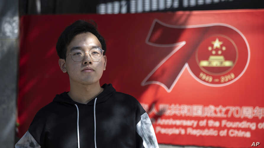 Chinese student Xiong Xiong poses for a photo in Beijing on Monday, Sept. 23, 2019. Xiong Xiong, an electrical engineering…