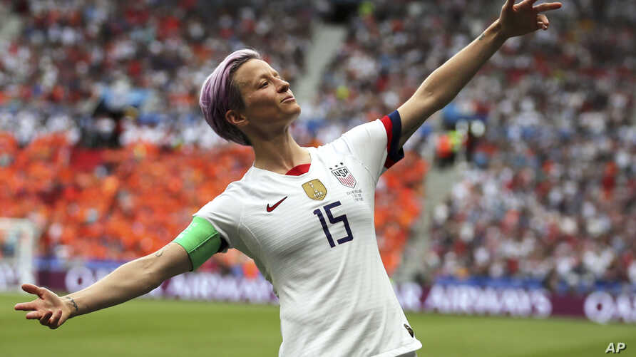 FILE - In this July 7, 2019 file photo, United States' Megan Rapinoe celebrates after scoring the opening goal from the penalty…