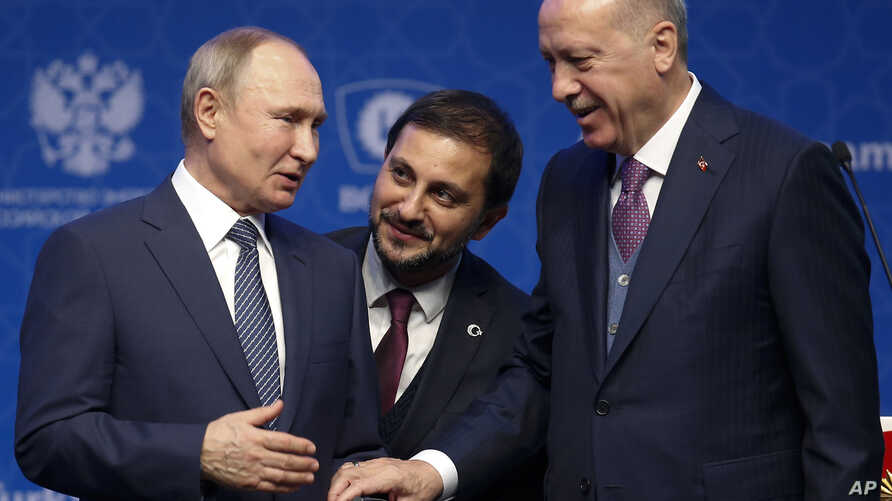 Turkey's President Recep Tayyip Erdogan, right and Russia's President Vladimir Putin, left, talk after they symbolically open a…
