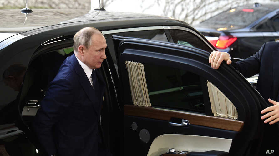 Russian President Vladimir Putin arrives for a conference on Libya at the chancellery in Berlin, Germany, Sunday, Jan. 19, 2020…