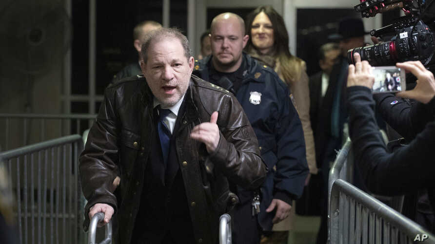 Harvey Weinstein gestures as he walks by reporters as he leaves a Manhattan courtroom after attending jury selection for his…