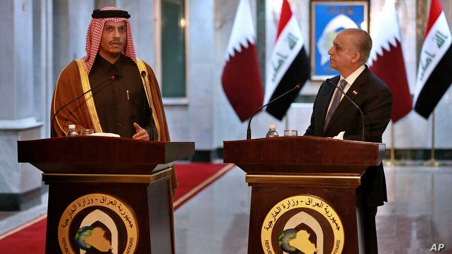 Iraqi Foreign Minister Mohamed Alhahkim, right, holds a press conference with visiting Qatari counterpart Sheikh Mohammed bin…