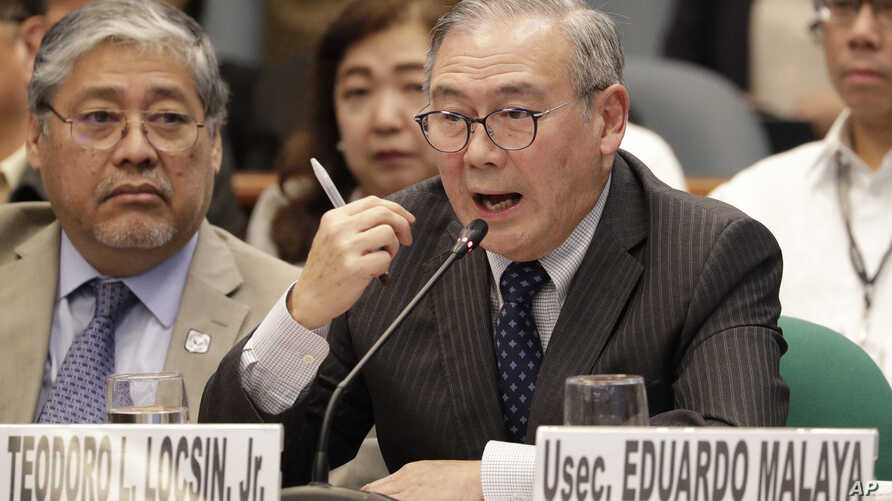 Philippine Secretary of Foreign Affairs Teodoro Locsin Jr. gestures during a senate hearing in Manila, Philippines on Thursday,…