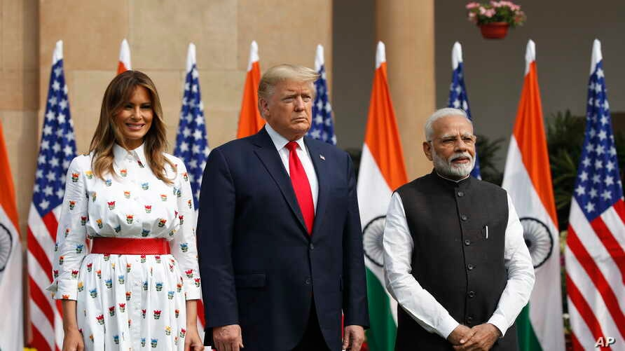 U.S. President Donald Trump, first lady Melania Trump and Indian Prime Minister Narendra Modi stand for photographs at…