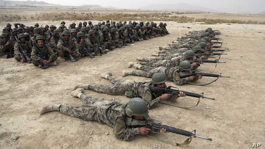 In this Wednesday, Oct. 31, 2018, photo, Afghan National Army (ANA) soldiers carry out an exercise during a live firing at the…