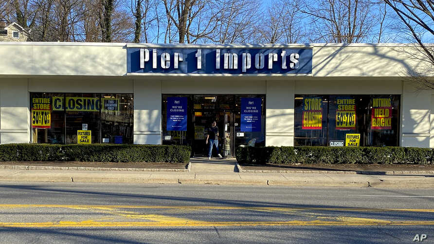 A customer steps out of a Pier 1 Imports store which was having a closeout sale, Monday, Feb. 17, 2020, in Larchmont, N.Y. Home…
