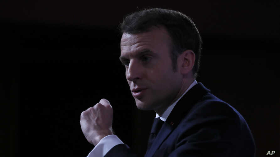French President Emmanuel Macron delivers a speech at the Ecole Militaire Friday, Feb. 7, 2020 in Paris. French President…