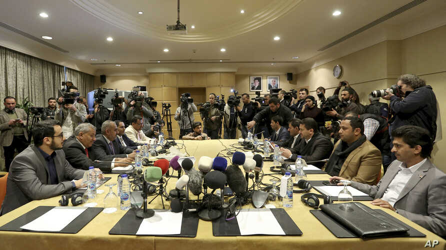 The Houthi rebel delegation, right, and delegates of the internationally recognized Yemeni government hold talks on a stalled prisoner exchange, in Amman, Jordan, Feb. 5, 2019.