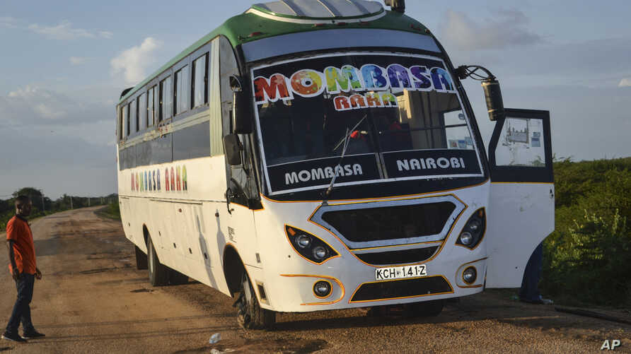 A man looks at a bus which was ambushed by gunmen in the Nyongoro area of Lamu county, near the Indian Ocean coast of Kenya…