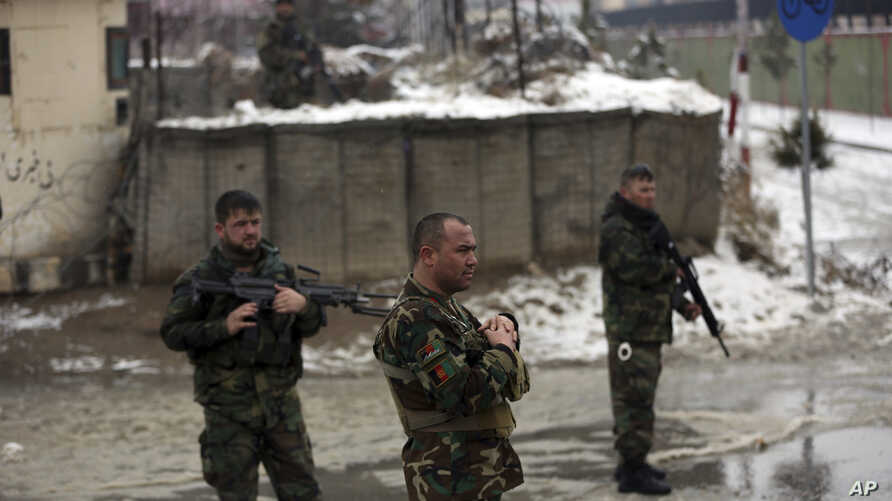 National army soldiers stand guard at the site of suicide attack near the military academy in Kabul, Afghanistan, Tuesday, Feb…