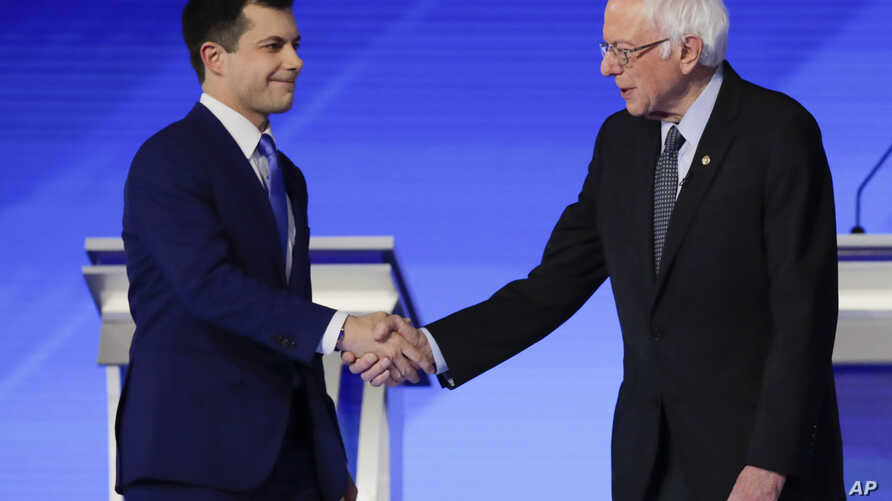 Democratic presidential candidates former South Bend Mayor Pete Buttigieg and Sen. Bernie Sanders, I-Vt., shake hands on stage…