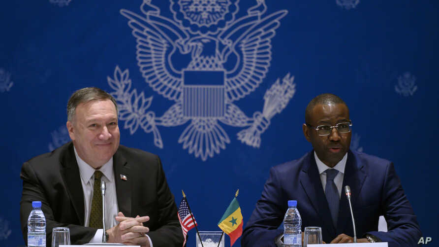 Senegal's Minister of Economy, Planning and International Cooperation Amadou Hott, right, and US Secretary of State Mike Pompeo…