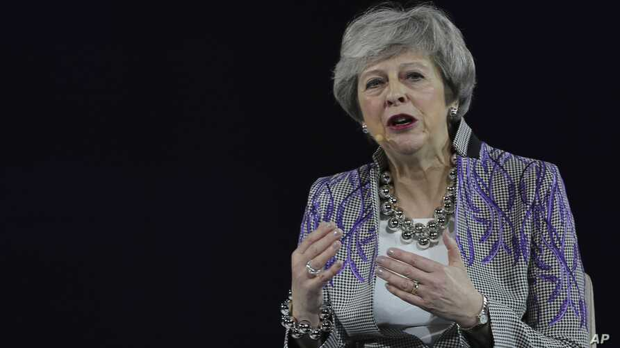 Former British Prime Minister Theresa May speaks at the Global Women's Forum in Dubai, United Arab Emirates, Monday, Feb. 17,…