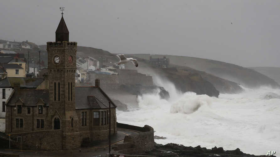 Powerful waves break on the shoreline around the small port of Porthleven, south west England, Sunday, Feb. 16, 2020. Storm…