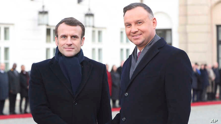 President Emmanuel Macron,left, of France and his Polish host, President Andrzej Duda, shake hands before talks on developing…
