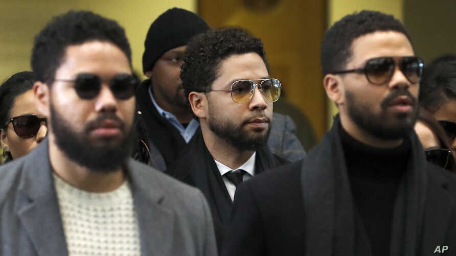 Actor Jussie Smollett, center, departs after an initial court appearance at the Leighton Criminal Courthouse, Monday, Feb. 24,…