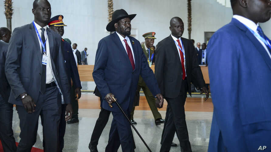 South Sudan's President Salva Kiir, center, arrives for the opening session of the 33rd African Union (AU) Summit at the AU…