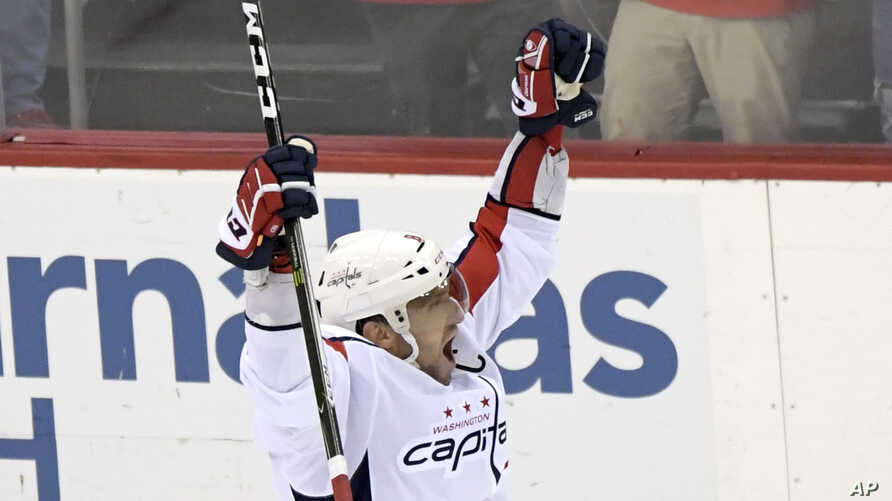 Washington Capitals left wing Alex Ovechkin (8) celebrates his 700th career goal during the third period of an NHL hockey game against the New Jersey Devils, Feb. 22, 2020, in Newark, New Jersey.