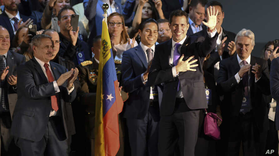 Venezuela's Juan Guaido waves at audience members before speaking at a rally in Miami, Saturday, Feb. 1, 2020. Guaido told a…