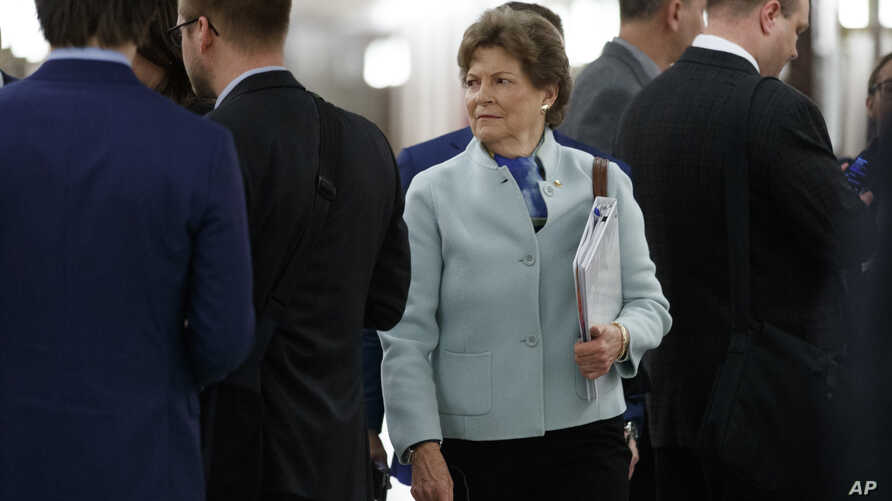 Sen. Jeanne Shaheen, D-N.H., arrives for a briefing on Capitol Hill in Washington, Thursday, March, 12, 2020, on the…
