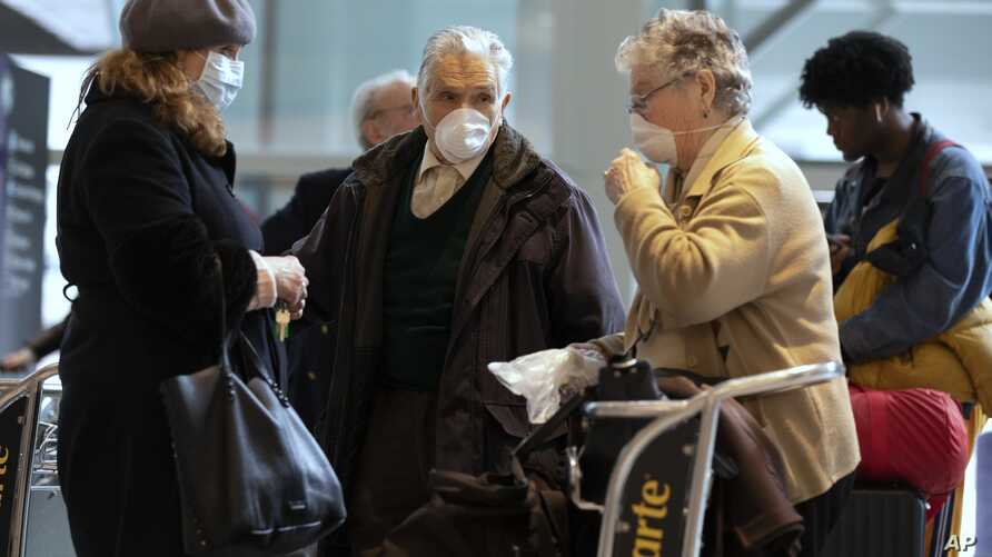 Passengers arrive on a flight from Germany at Logan International Airport in Boston, Friday, March, 13, 2020. Beginning at…