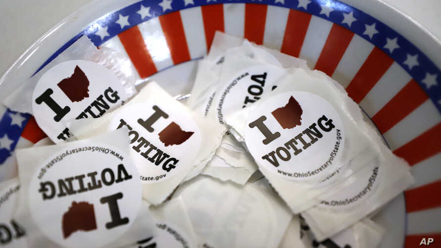 I voted stickers are seen at a polling place, Sunday, March 15, 2020, in Steubenville, Ohio. Elections officials in the four…