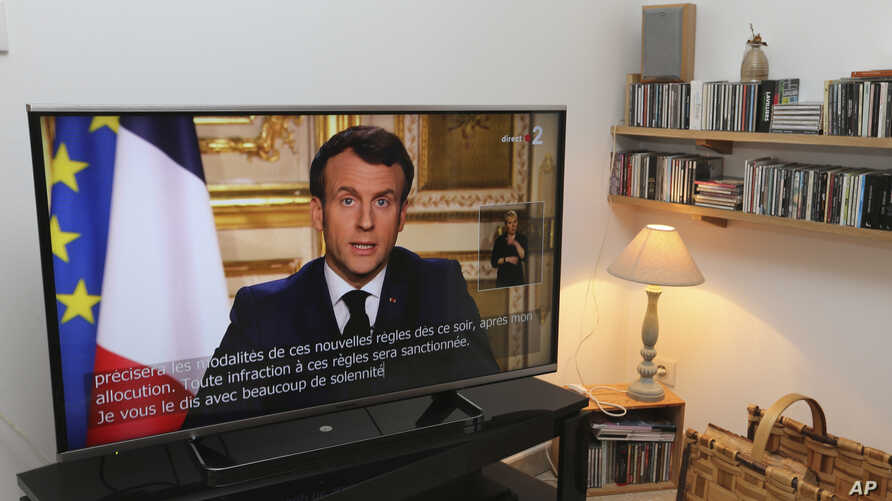 French President Emmanuel Macron speaks during a television address, Monday, March 16, 2020 in Ciboure, southwestern France…